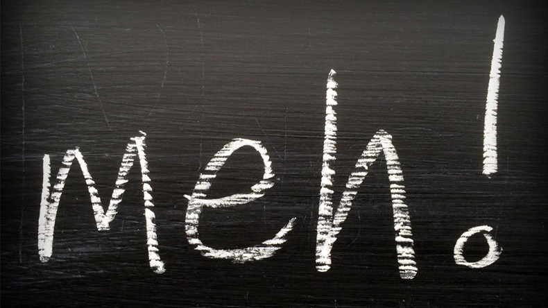The word Meh written on a blackboard in white chalk as an expression of boredom or indifference when giving an opinion