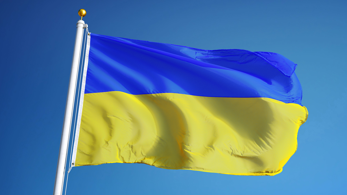 Ukraine flag waving against clean blue sky, close up, isolated with clipping path mask alpha channel transparency