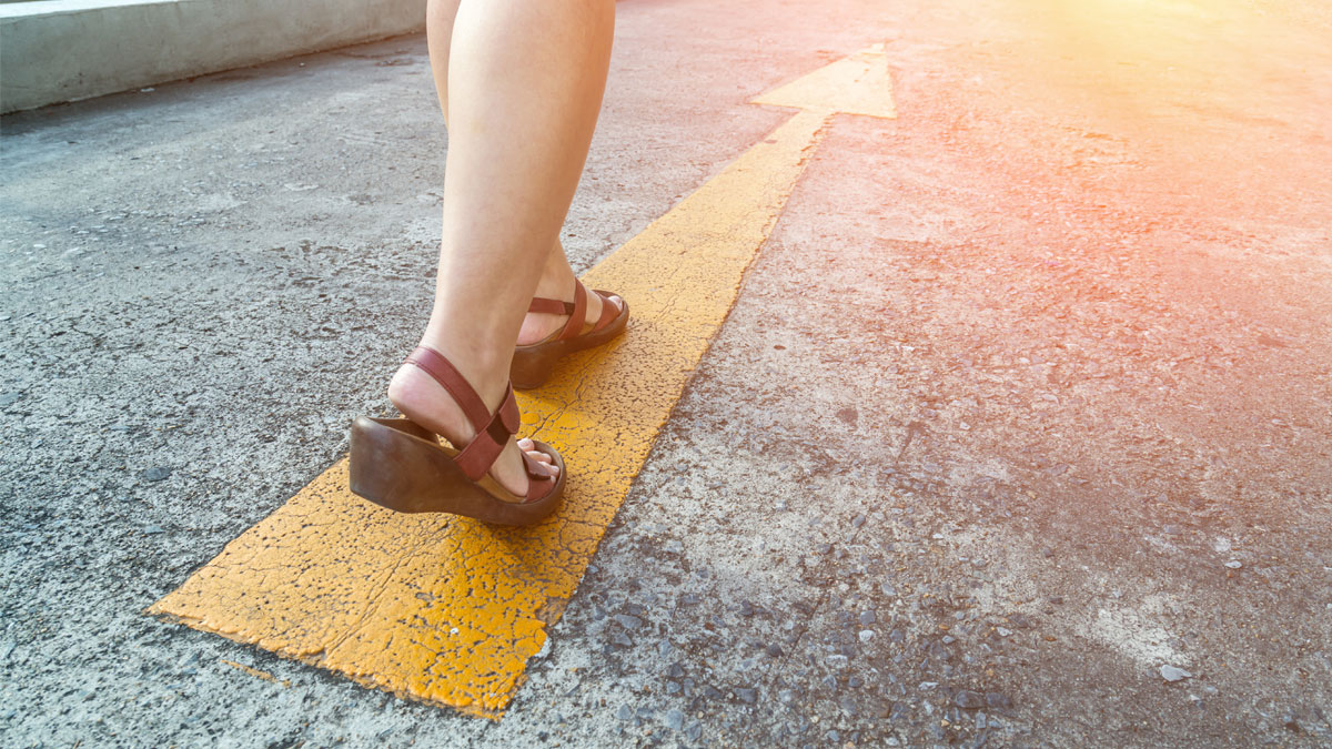 yellow direction street sign with walk of woman in leather shoe business leader concept - Image