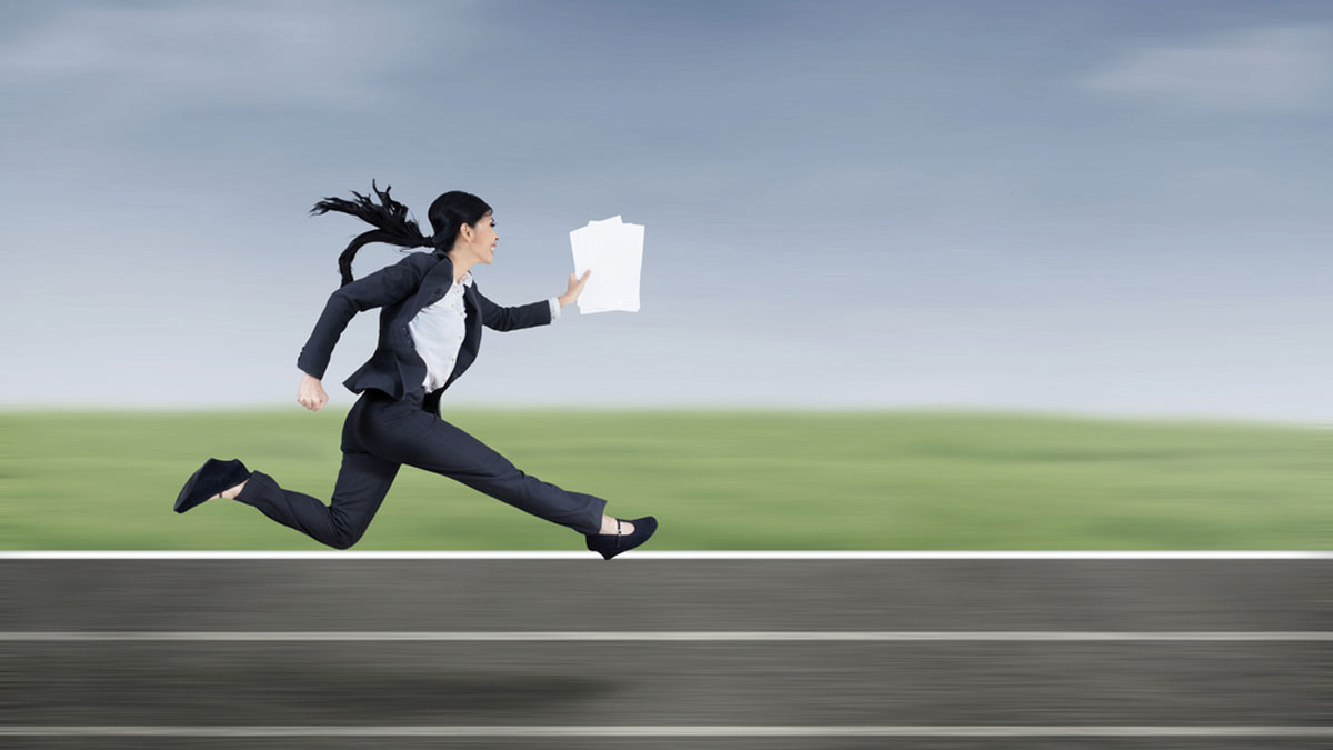 The young beautiful businesswoman runs by holding business paper - Image