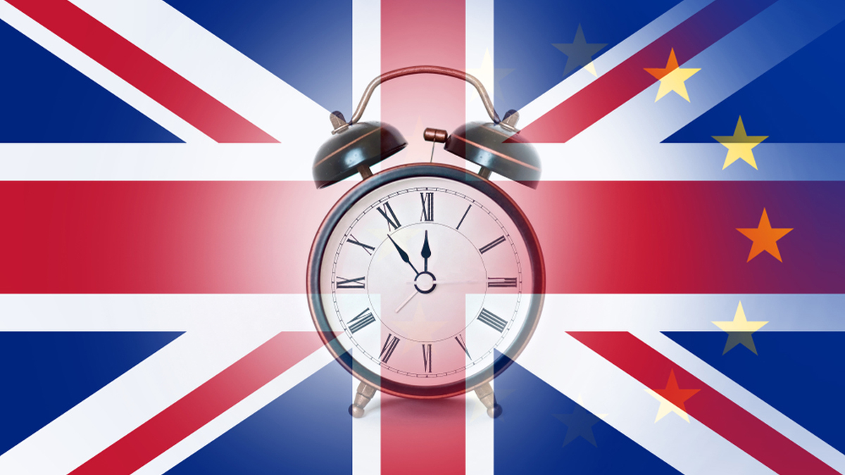 A BREXIT deadline concept. With an alarm clock over layered with the union Jack and E.U flags. - Image