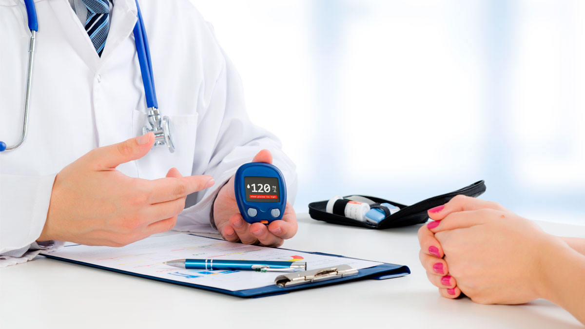 Doctor shows glucometer with glucose level. doctor patient diabetes glucometer blood glucose office hand concept