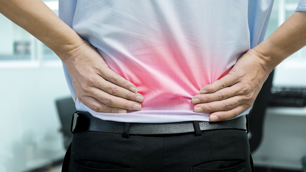 A man in blue shirt feeling pain on his back. Office syndrome. Back pain from work. Herniated nucleus pulposus. spine pain. spinal degeneration. - Image