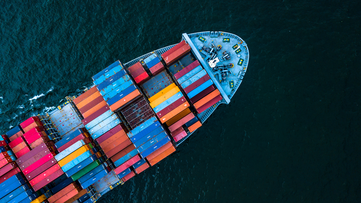 Aerial top view container cargo ship in import export business logistic and transportation of international by container cargo ship in the open sea, with copy space. - Image