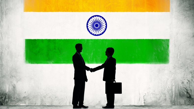 Two Businessmen Shaking Hands With Flag of India