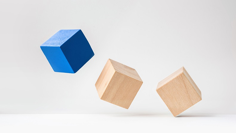 Abstract geometric real wooden cube with surreal layout on white floor background