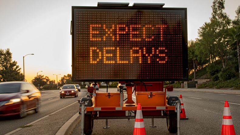 "Street sign reading ""Expect Delays"""