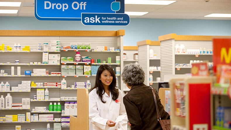 Female CVS retail pharmacist with patient
