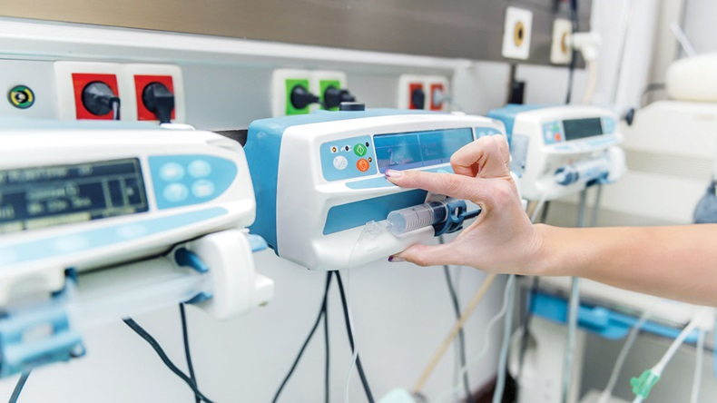 Intensive care infusion pump adjusted by a doctor hand