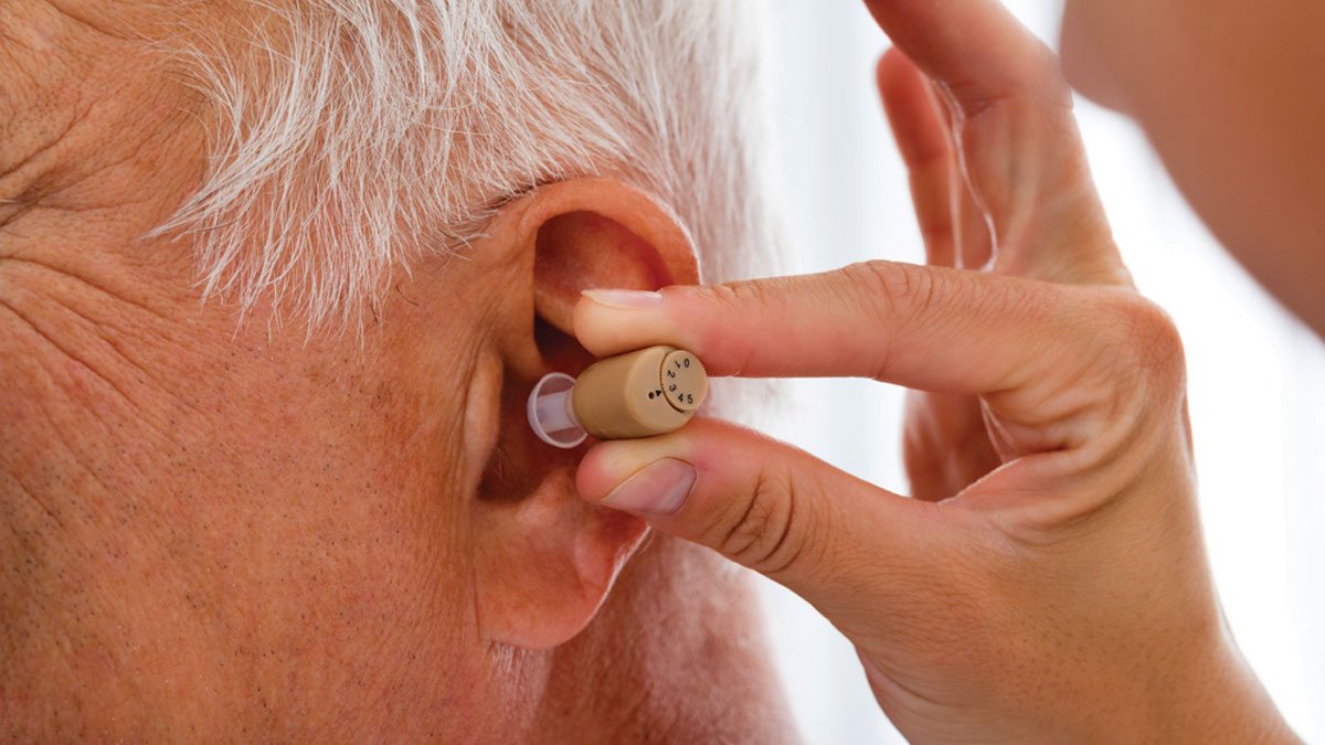 Putting Hearing Aid In
