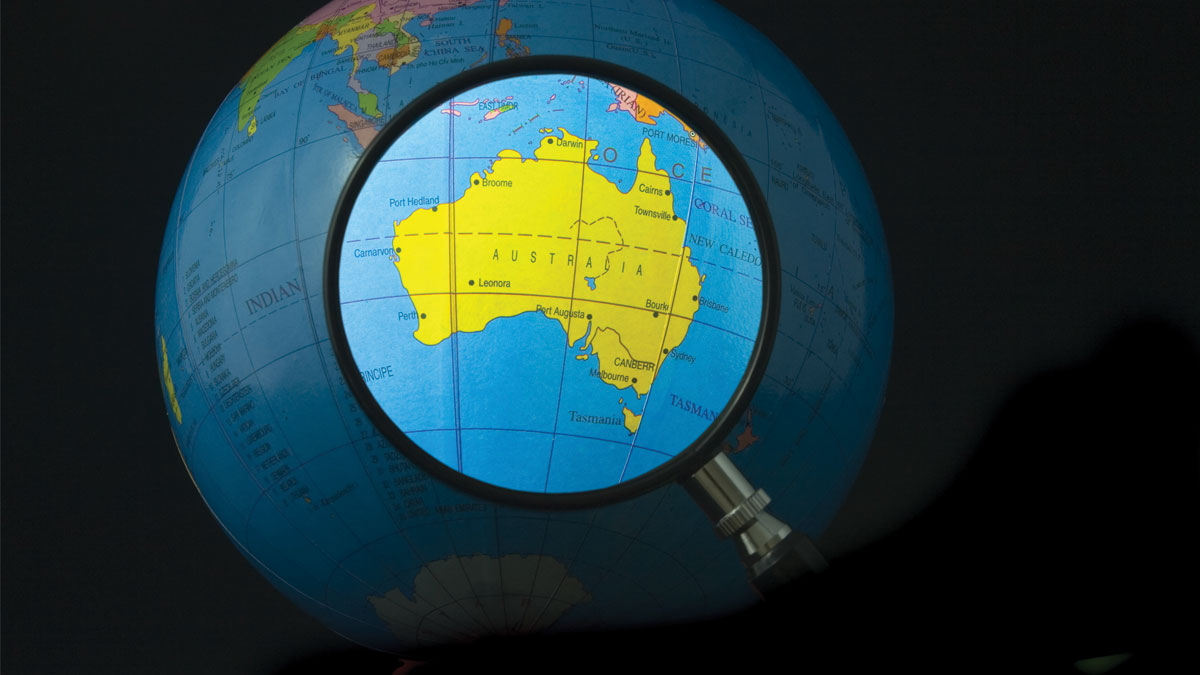 Magnifying glass focusing on Australia