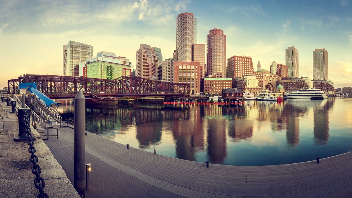 View of the Boston Harbor in Boston, Massachusetts, USA with its mix of modern and historic architecture in a cross processed image.
